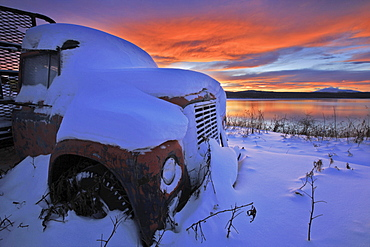 Sunset over abandoned truck along the shore of Teslin Lake, Yukon