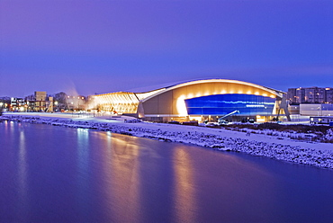 The Richmond Olympic Oval at sunset, the speed skating venue for the 2010 Olympic and Paralympic Winter Games, looking eastward over the North Branch of The Fraser River, Richmond, British Columbia