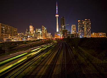 CN Tower and train tracks at night, Toronto, Ontario