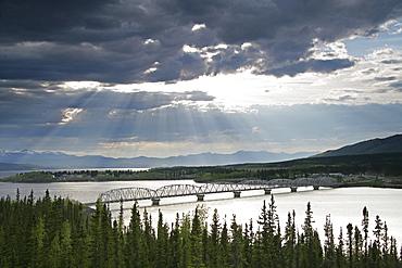 Sun Shining through Clouds over Bridge on Nisutlin Bay, Teslin, Yukon