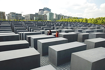 Young women at the Memorial to the Murdered Jews of Europe, Berlin, Germany