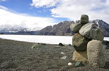 Inukshuk along the spring-time shores of the Frozen Kluane Lake, Kluane National Park, Yukon