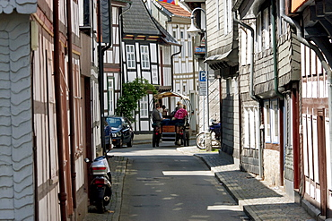 Horse cart tour on a street with half-timbered buildings, Goslar, Germany