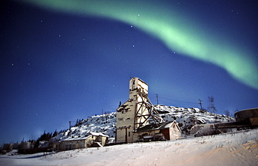 Old Gold Mine site in the NWT just north of Yellowknife with Northern Lights above, Canada Not Property Released