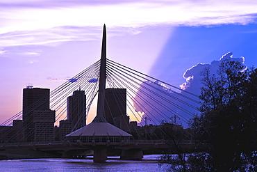 Winnipeg skyline and Esplanade Riel Bridge, from Red River at sunset, Winnipeg, Manitoba