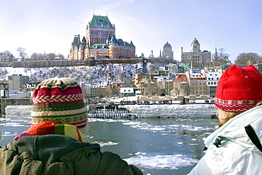 Two people looking at the frozen Saint Lawrence river and Chateau Frontenac, Quebec City