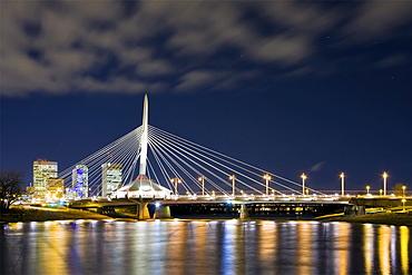 Downtown Winnipeg skyline and The Esplanade Riel Bridge at night, Red River, Winnipeg, Manitoba