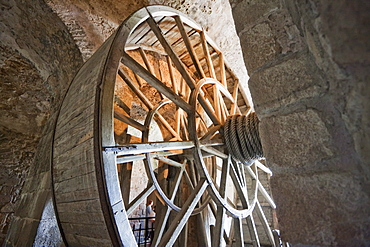 Giant wheel used as pulley to hoist provisions from the 19th century located in the ossuary of the Abbey of Mont-Saint-Michel, France