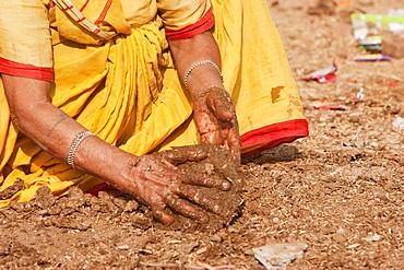 Woman making cow dung patties, Bodhgaya, Bihar, India