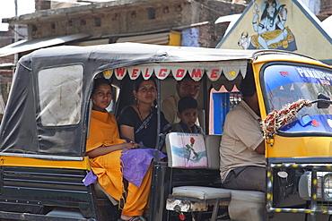 People in an autorickshaw, Gaya, Bihar, India