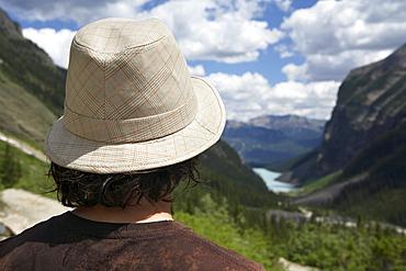 Young man looking out at Lake Louise, Banff, Alberta