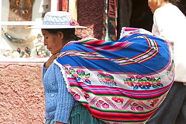 Aymara woman carrying a huge cloth bag on her back, La Paz, Bolivia