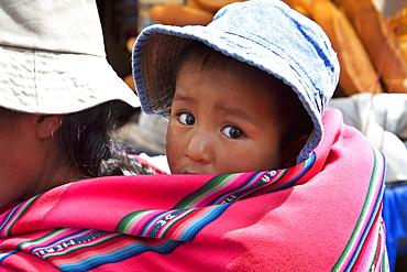 Girl on her mother's back, La Paz, Bolivia