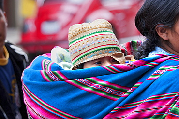 Aymara woman carrying a baby on her back, La Paz, Bolivia