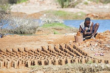 Brick makers, Antsokay, Toliara Province, Madagascar
