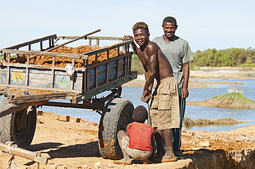 Fixing a tire on a cart in Antsokay, Toliara Province, Madagascar