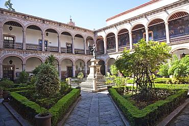 Statue of Father Miguel Hidalgo in the courtyard of the Colegio de San Nicolus Hidalgo, Morelia, Michoacun, Mexico