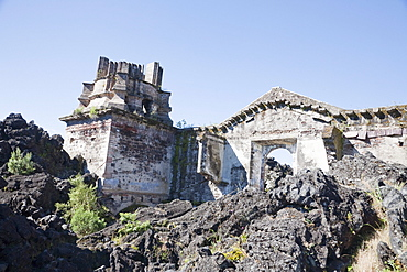 Remains of the San Juan Parangaricutiro Church destroyed by the Paricutin Volcano eruption from 1943 to 1952, Michoacun, Mexico