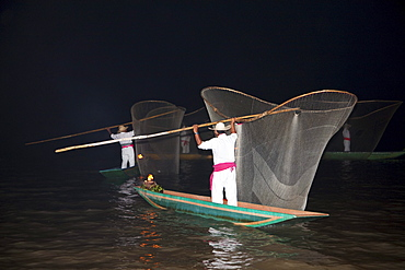 Fisherman with butterfly nets in Lake Putzcuaro at night, Michoacun, Mexico