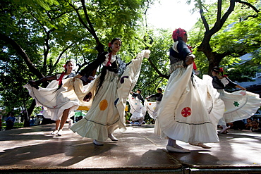 Women wearing traditional dress performing a Paraguayan polka, Asuncion, Paraguay