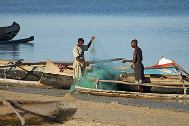 Fishermen preparing their boats in Mangily, Toliara Province, Madagascar