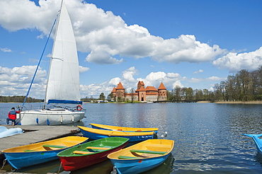 Sail boats on Galve Lake with the Island Castle in the background -Trakai, Lithuania