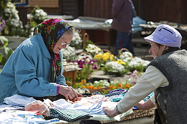 Woman selling clothes in Trakai, Lithuania