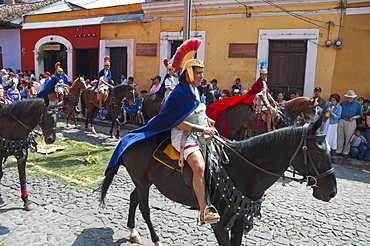 Men dressed as Roman soldiers on horseback at the Procession of the Holy Cross on Good Friday in Antigua Guatemala, Sacatepuquez, Guatemala