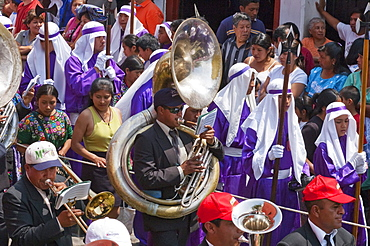 A music band plays funeral marches during the Procession of the Holy Cross on Good Friday in Antigua Guatemala, Sacatepuquez, Guatemala