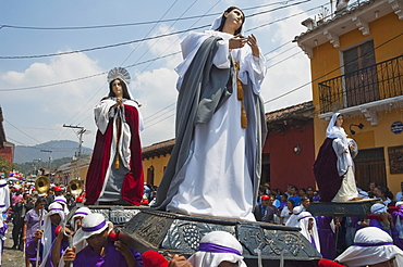 Men carrying the andas (floats) of the Virgin Mary at the Procession of the Holy Cross on Good Friday in Antigua Guatemala, Sacatepuquez, Guatemala