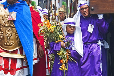 Men and boys wear purple as a sign of mourning at the Procession of the Holy Cross on Good Friday in Antigua Guatemala, Sacatepuquez, Guatemala