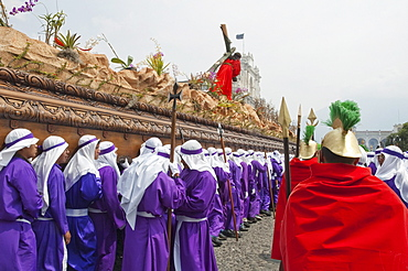 Men carrying the anda (float) of Jesus carrying the Cross during the Procession of the Holy Cross on Good Friday in Antigua Guatemala, Sacatepuquez, Guatemala