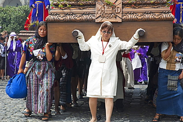 Woman guiding the anda (float) of the sorrowful Virgin Mary during a Good Friday Procession in Antigua Guatemala, Sacatepuquez, Guatemala