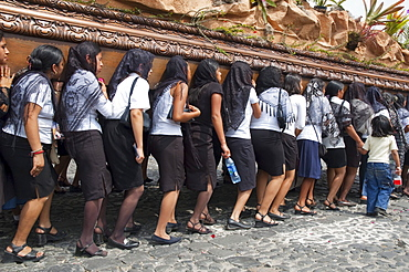 Women dressed in mourning carry the anda (float) of the sorrowful Virgin Mary during a Good Friday Procession in Antigua Guatemala, Sacatepuquez, Guatemala
