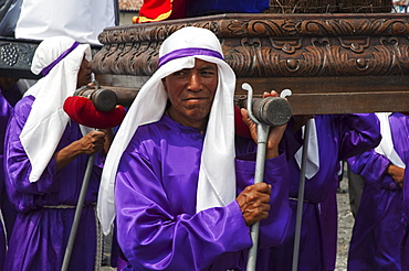 Men carrying the andas (Floats) of Saints during the Procession of the Holy Cross on Good Friday in Antigua Guatemala, Sacatepuquez, Guatemala