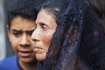 Woman dressed in mourning at the Holy Burial Procession on Good Friday in Antigua Guatemala, Sacatepuquez, Guatemala