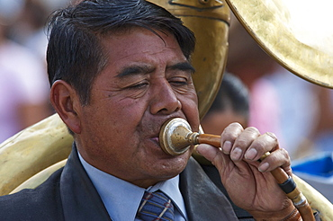 Tuba player playing funeral marches at the Holy Burial Procession on Good Friday in Antigua Guatemala, Sacatepuquez, Guatemala