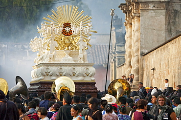 People following the anda (float) of the sorrowful Virgin Mary during the Holy Burial Procession on Good Friday in Antigua Guatemala, Sacatepuquez, Guatemala