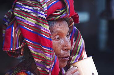 Old Maya woman drinking tea, Chichicastenango, El Quichu, Guatemala