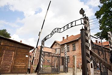 Main gate with the 'Arbeit macht frei' slogan over it, Auschwitz Concentration Camp, Oswiecim, Malopolska, Poland