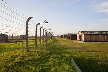 Electrified barbed wire fence along the medical barracks, Auschwitz-Birkenau Concentration Camp, Oswiecim, Malopolska, Poland
