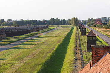 View of the watchtowers along the camp perimeter from the main guard house (Gate of Death), Auschwitz-Birkenau Concentration Camp, Oswiecim, Malopolska, Poland