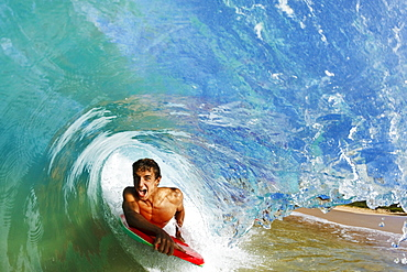Hawaii, Maui, Makena - Big Beach, Boogie boarder riding barrel of beautiful wave.
