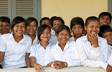 South East Asia, Cambodia, Siem Reap, A group of young school children gather for a class photo.