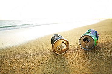 Hawaii, Oahu, Aluminum cans on the beach.