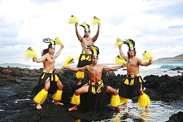 Hawaii, Oahu, Group of Tahitian Male Dancers posing.