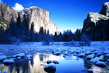 California, Yosemite National Park, Yosemite Valley, Snowy landscape of El Capitan and Merced River.