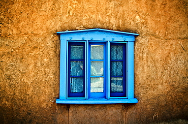 Northern New Mexican Windows, New Mexico, Blue deep-seated window on adobe wall.