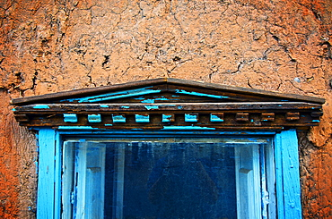 Cracked Blue Paint, New Mexico, Details of cracked adobe wall and painted blue 19th century window.