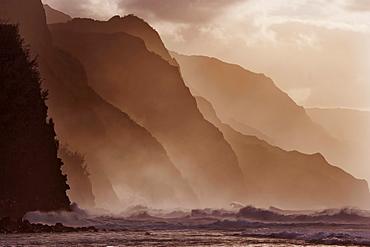 Hawaii, Kauai, North Shore, Na Pali Coast, Haena, Misty waves at dusk.
